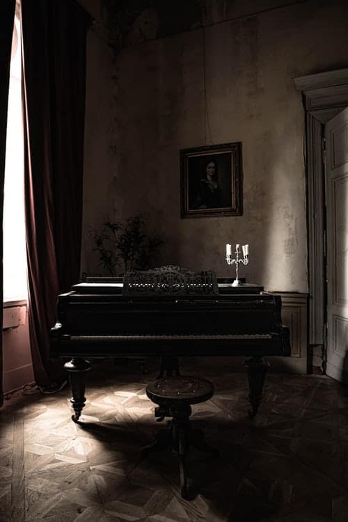 Grand Piano Near White Curtain