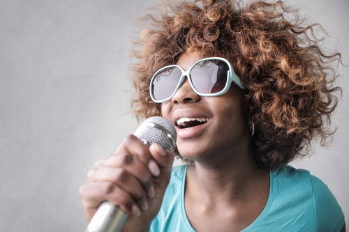 Lady with Sunglasses Singing